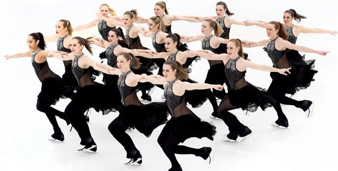 Synchronized women skaters performing on the ice